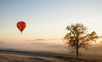 Enjoy wine and the sunset on a hot air balloon ride over the Vineyards of Montgolfière, Saint-Emilion
