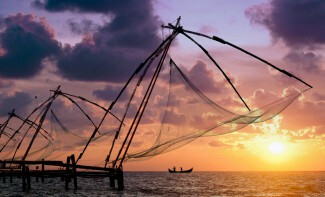 Admire the Chinese nets of Fort Cochin